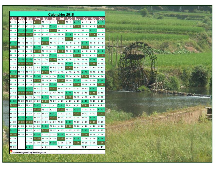 Calendrier 2018 annuel à imprimer, une colonne par mois, format paysage, placé sur une photographie