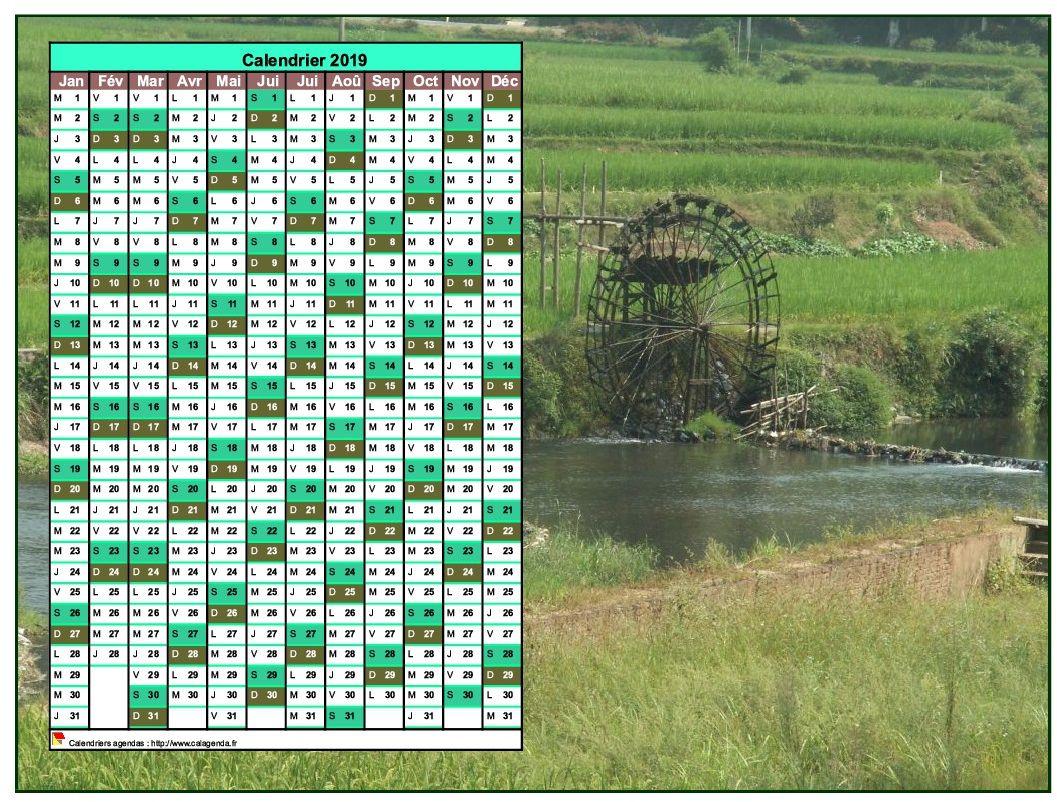 Calendrier 2019 annuel à imprimer, une colonne par mois, format paysage, placé sur une photographie